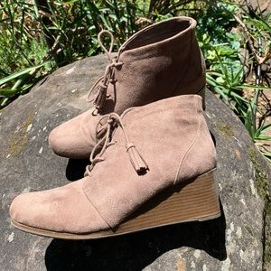 Taupe suede wedge heel booties with tassel laces